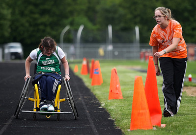 Kyle Grillot - kgrillot@shawmedia.com   Michele Lynch is cheered on by her coach Maggie Wood-Davis after competing in the 200-meter dash during the sixth annual Run and Roll Track Meet, a Paralympic Experience at McHenry High School's McCracken Field on Saturday, June 1, 2013. This is the last event in the area to qualify for the National Junior Disability Championships in Rochester, Minnesota.