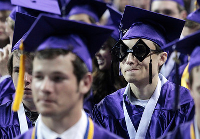 Kyle Grillot - kgrillot@shawmedia.com    Senior Brian Calderon waits after receiving his diploma  during the Hampshire Commencement Saturday at the Sears Centre.