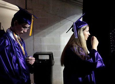 Kyle Grillot - kgrillot@shawmedia.com   Graduates and Matthew Burkett and Abigail Burke wait to enter the arena before the Hampshire Commencement Saturday at the Sears Centre.