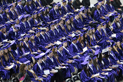 Kyle Grillot - kgrillot@shawmedia.com   Graduates listen as the Principal Chuck Bumbales gives a speech during the Hampshire Commencement Saturday at the Sears Centre.