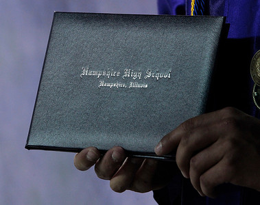Kyle Grillot - kgrillot@shawmedia.com   Micheal Dumoulin holds his diploma as he poses for a portrait during the Hampshire Commencement Saturday at the Sears Centre.