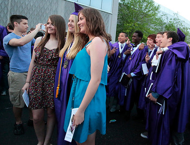 Kyle Grillot - kgrillot@shawmedia.com   Graduates reconnoiter with friends and family  after the Hampshire Commencement Saturday at the Sears Centre.