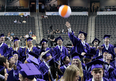 Kyle Grillot - kgrillot@shawmedia.com   Senior Eric Follman reaches out to hit a beach ball during the Hampshire Commencement Saturday at the Sears Centre.