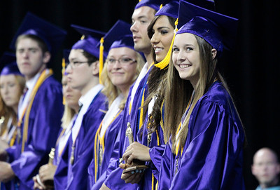 Kyle Grillot - kgrillot@shawmedia.com   Honor student Sydney Zilch smiles as her name is mispronounced during the Hampshire Commencement Saturday at the Sears Centre.