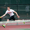 St. Charles East's Justin Bowman returns the ball during his first round match in the IHSA Boys State Tennis Tournament against Eric Marbach of Waubonsie Valley at Rolling Meadows High School Thursday.