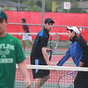Geneva's Ryan Doeckel (left) and Nick Huang (right) high-five after a point during the IHSA Boy's State Tennis Tournament against Boylan Catholic at Schaumburg High School. Geneva lost the first round match 3-6 3-6.
