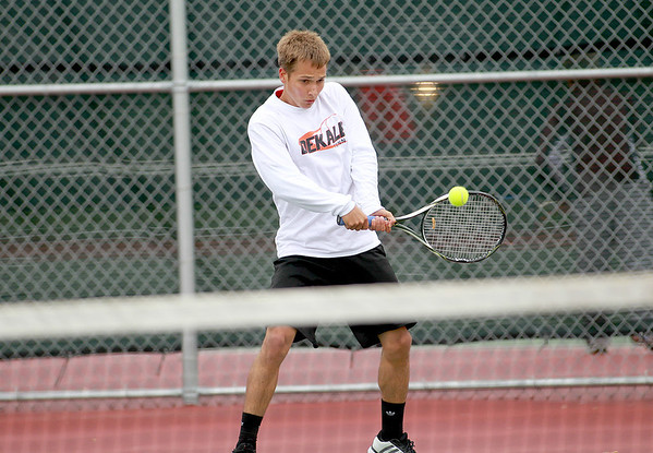 DeKalb's  Matt Kulma returns the ball during his first round match in the IHSA Boys State Tennis Tournament at Rolling Meadows High School Thursday.