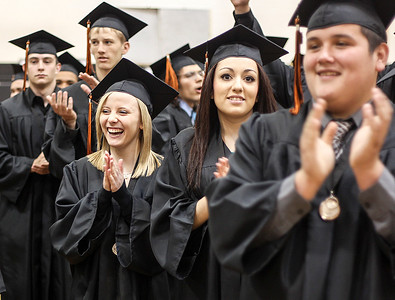 Sarah Nader - snader@shawmedia.com Graduate April Guzy (left) waits in line with her classmates before the 2013 Crystal Lake Central High School commencement on Saturday, May 25, 2013. Guzy plans to study forensic chemistry at Western this fall.