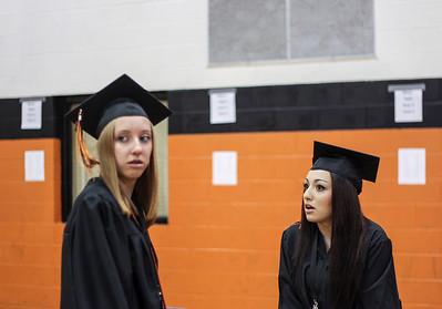 Sarah Nader - snader@shawmedia.com Graduates Melissa Benton (left) and Jocelyn Guzman talk before the 2013 Crystal Lake Central High School commencement on Saturday, May 25, 2013.