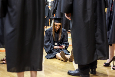 Sarah Nader - snader@shawmedia.com Graduate Casey Vacala sits down while waiting to walk in the gym for the 2013 Crystal Lake Central High School commencement on Saturday, May 25, 2013. Vacala plans to study physical therapy at McHenry County College this fall