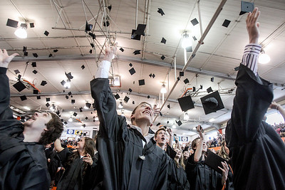 Sarah Nader - snader@shawmedia.com Graduate Jason Arendt (center) throws his cap in the air during the 2013 Crystal Lake Central High School commencement on Saturday, May 25, 2013.