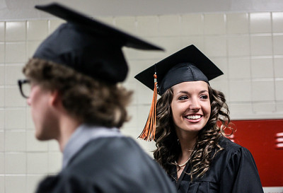 Sarah Nader - snader@shawmedia.com Graduate Tawney Dobosz waits in the hall with her classmates during the 2013 Crystal Lake Central High School commencement on Saturday, May 25, 2013.
