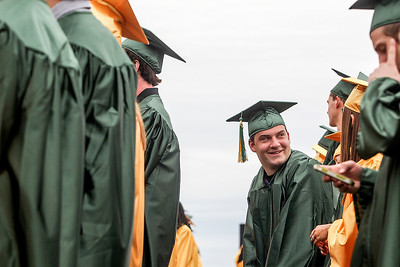 Sarah Nader - snader@shawmedia.com Graduate Stephen Kuta looks down the row during the 2013 Crystal Lake South High School commencement on Saturday, May 25, 2013. 457 students graduated during the ceremony.