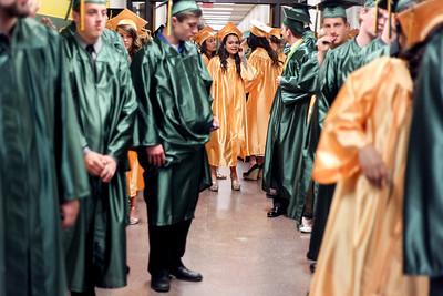 Sarah Nader - snader@shawmedia.com Graduates wait inside the school before the 2013 Crystal Lake South High School commencement on Saturday, May 25, 2013. 457 students graduated during the ceremony.