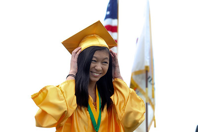 Sarah Nader - snader@shawmedia.com Valedictorian Irene Feng walks back to her seat after giving her speech during the 2013 Crystal Lake South High School commencement on Saturday, May 25, 2013. 457 Feng plans to study at Dartmouth this fall.
