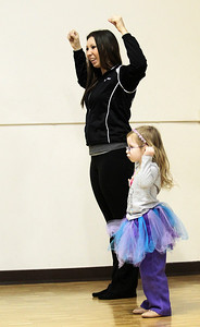 Kyle Grillot - kgrillot@shawmedia.com   Lea Lasco, 4, of Fox River Grove works on her routine with lead instructor Chrissy Rossi at the Dancepiration studio on Saturday. Dancepiration started several classes for special needs children after Physical Trainer Beth Saip proposed the idea. Now in their second year of the classes, dancepiration is looking to branch out and offer more classes for younger children.
