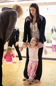 Kyle Grillot - kgrillot@shawmedia.com   Dancepiration started several classes for special needs children after Physical Trainer Beth Saip proposed the idea. Becca Ferio of Cary walks with Taylor Way, 5, of Algonquin. Now in their second year of the classes, dancepiration is looking to branch out and offer more classes for younger children.