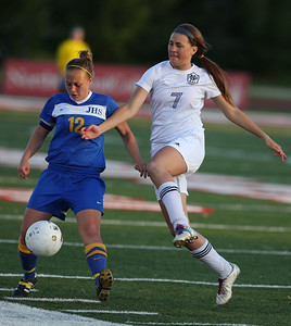 Sarah Nader - snader@shawmedia.com Johnsburg's Shelby Weaver (left) and Notre Dame's Hannah Marcolla fight for control of the ball during the second half of Friday's IHSA 1A State Girls Soccer Semifinal in Naperville on May 24, 2013. Johnsburg lost, 2-5.