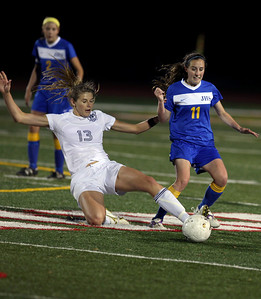 Sarah Nader - snader@shawmedia.com Notre Dame's Jordan Frericks (left) tries to steal the ball from Johnsburg's Sarah Weaver during the second half of Friday's IHSA 1A State Girls Soccer Semifinal in Naperville on May 24, 2013. Johnsburg lost, 2-5.