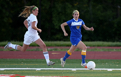 Sarah Nader - snader@shawmedia.com Notre Dame's Adriel (left) tries to catch up to Johnsburg's Delaney Pruitt during the first half of Friday's IHSA 1A State Girls Soccer Semifinal against in Naperville on May 24, 2013. Johnsburg lost, 2-5.