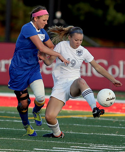 Sarah Nader - snader@shawmedia.com Johnsburg's Marje Nusseer (left) and Notre Dame's Hannah Thomas fight for control of the ball during the first half of Friday's IHSA 1A State Girls Soccer Semifinal in Naperville on May 24, 2013. Johnsburg lost, 2-5.