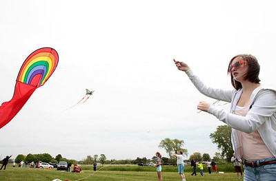 Kyle Grillot - kgrillot@shawmedia.com   Rhiannon Neri, 13, of Crystal Lake flies a kite during the kite festival Sunday at Lippold Park. The first 250 children receive a free kite kit and a demonstration on how to assemble the kite with a help from Chicago Kite Experts.