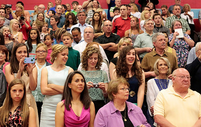 Kyle Grillot - kgrillot@shawmedia.com   Spectators watch from the gymnasium before the start of the Marian Central Catholic High School commencement Friday May 31, 2013.