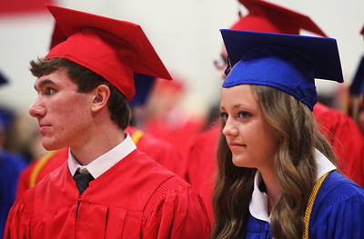 Kyle Grillot - kgrillot@shawmedia.com   Micheal Borkowski and Caitlin Brocker wait in the gymnasium before the start of the Marian Central Catholic High School commencement Friday May 31, 2013.