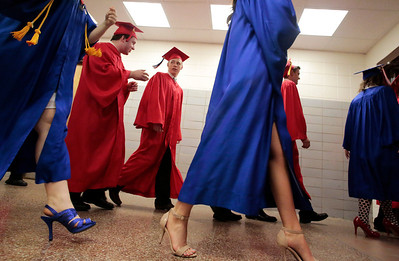 Kyle Grillot - kgrillot@shawmedia.com   Graduates walk towards the gymnasium before the start of the Marian Central Catholic High School commencement Friday May 31, 2013.