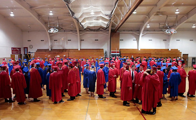 Kyle Grillot - kgrillot@shawmedia.com   graduates gather in the gymnasium before the start of the Marian Central Catholic High School commencement Friday May 31, 2013.
