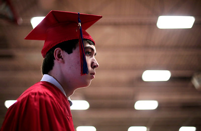 Kyle Grillot - kgrillot@shawmedia.com   Keith Kranenburg waits to walk across the stage during the Marian Central Catholic High School commencement Friday May 31, 2013.