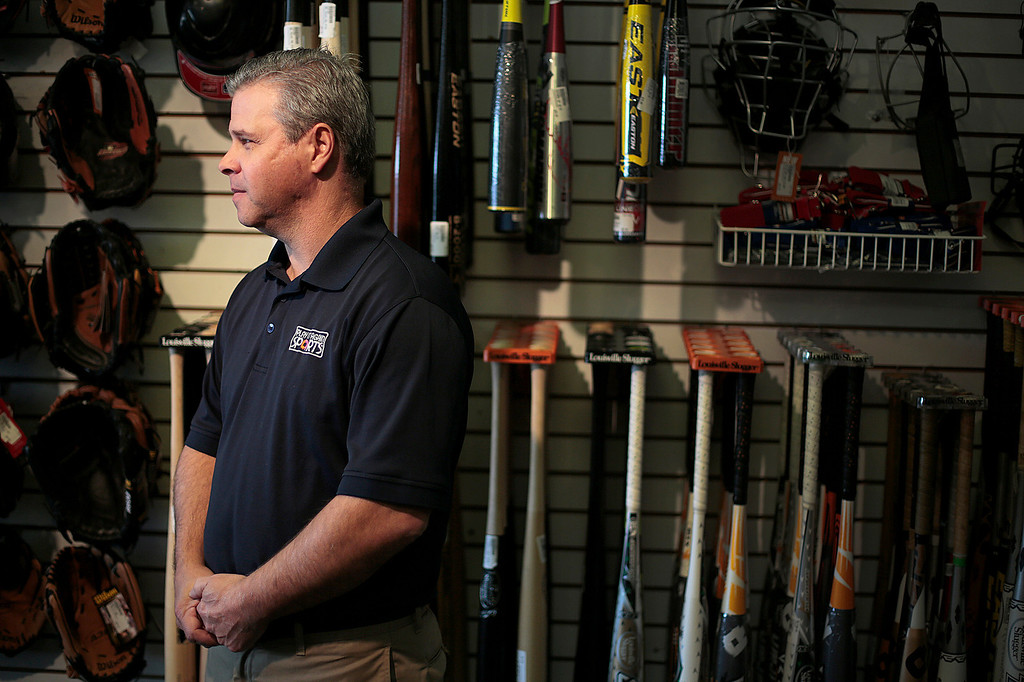 Kyle Grillot - kgrillot@shawmedia.com   Bob Ruer, owner of Play it Again Sports poses for a portrait inside his Crystal Lake store on Tuesday, April 25, 2013. Customer interaction is one reason supporters of the internet sales tax legislation say separates their business from online shopping companies like Amazon or Overstock.com.