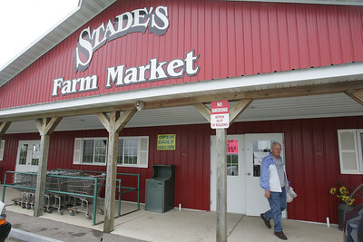 "Kyle Grillot - kgrillot@shawmedia.com   Stades Farm Market is open for the second weekend of this year as Rick Husted of Johnsburg exits the McHenry storefront Friday. ""I come here all year, Husted said, "" They have the best sweet corn around."" The market is open from May to October with current hours on the weekends until strawberry season in June."