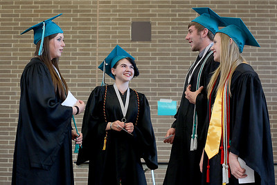 Sarah Nader - snader@shawmedia.com Shelby Nicholson (left), Rraine Nolan, Trevor Nomm and Jacqueline Nordvall line up before the 2013 commencement ceremony for Woodstock North High School in Woodstock on Saturday, May 18, 2013. Humphrey plans to study at McHenry County College in the fall.