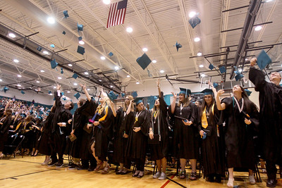 Sarah Nader - snader@shawmedia.com Graduates throw their caps in the air after the 2013 commencement ceremony for Woodstock North High School in Woodstock on Saturday, May 18, 2013. Humphrey plans to study at McHenry County College in the fall.