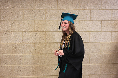 Sarah Nader - snader@shawmedia.com Jennifer Conley, 18, of Wonder Lake lines up with other graduates during the 2013 commencement ceremony for Woodstock North High School in Woodstock on Saturday, May 18, 2013.