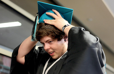 Sarah Nader - snader@shawmedia.com Steven Humphrey, 18, of Wonder Lake fixes his cap before the 2013 commencement ceremony for Woodstock North High School in Woodstock on Saturday, May 18, 2013. Humphrey plans to study at McHenry County College in the fall.