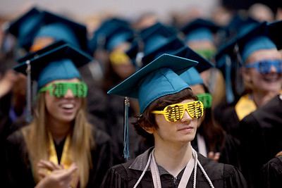 Sarah Nader - snader@shawmedia.com Graduates rock 2013 sunglasses during a rap by two students during the 2013 commencement ceremony for Woodstock North High School in Woodstock on Saturday, May 18, 2013. Humphrey plans to study at McHenry County College in the fall.