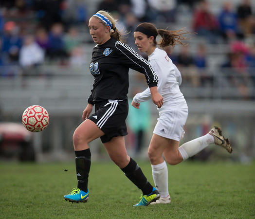 Geneva's Taylor Williams (20) pushes the ball on a break against Batavia's forward Olivia Callipari (6) at Batavia High School in Batavia, IL on Tuesday, April 29, 2014 (Sean King for Shaw Media)