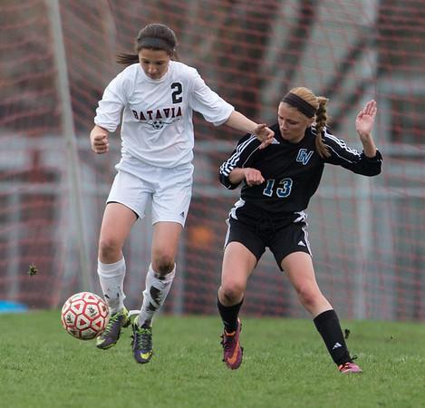 Batavia's Megan McEachern (2) plays the ball against Geneva's Megan Newingham (13) at Batavia High School in Batavia, IL on Tuesday, April 29, 2014 (Sean King for Shaw Media)