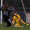 Batavia's goal keeper Lauren Suhi (1) makes a point blank save against Geneva's Mary Landry (21) at Batavia High School in Batavia, IL on Tuesday, April 29, 2014 (Sean King for Shaw Media)