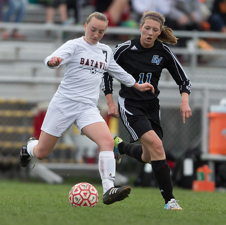 Batavia's Alexis Bryl (7) and Geneva's Michaela Loebel (11) play the ball in the middle of the field at Batavia High School in Batavia, IL on Tuesday, April 29, 2014 (Sean King for Shaw Media)