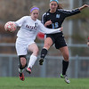 Batavia's Tori Renfus (10) plays the ball against Geneva's Maggie Bondine (12) at Batavia High School in Batavia, IL on Tuesday, April 29, 2014 (Sean King for Shaw Media)