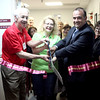 (Left to right) The Pride of the Fox co-founders Jon Olson, Julie Farris and Pride of the Fox Board President Ed Bessner cut the ribbon to the Pride of the Fox and JMF Events office, which is located at 103 N. 11th Avenue, Suite 110 in St. Charles.