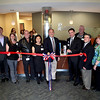 Sugar Grove Village President Sean Michels (center) is joined by Sugar Grove Chamber of Commerce, Cadence and other village officials to cut the ribbon to the new Cadence Physician Group in Sugar Grove.