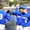 Jeff Krage – For Shaw Media<br /> Geneva's Nick Derr (#3) scores in the 6th inning in game one of Saturday's doubleheader and is congratulated by teammate's (left to right) Nathan Montgomery, Nick Fitzmaurice and Nick Porretto. The run gave the Vikings a 3-2 lead which held.<br /> Geneva 5/3/14