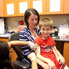 Patrick Hanlon, 7, of Geneva, with his mom, Nicole, gets his allergy shots from medical assistant Sharlinda Johnson  at the Kaneland Allergy and Asthma Center in North Aurora.