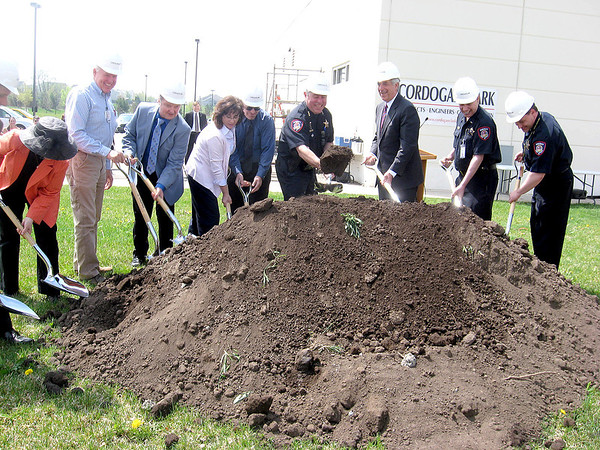 Kane County Sheriff Pat Perez and Kane County Board Chairman Chris Lauzen, both center, toss ceremonial shovelfuls of dirt Friday during the groundbreaking ceremony for the Kane County Regional Training Center in St. Charles Township. County Board members and other sheriff's officials helped mark the occassion.