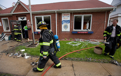 Firefighters clean up after a fire destroyed Polish Legion of American Veterans Post 188 Sunday, May 11, 2014 in McHenry.  John Konstantaras / for the Northwest Herald