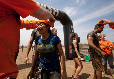 First time finishers get headbands after completing the Tough Mudder at the Richmond Hunt Club Sunday, May 11, 2014 in Richmond. The event draws 10,000 to 15,000 people to 10-12-mile obstacle courses. John Konstantaras / for the Northwest Herald